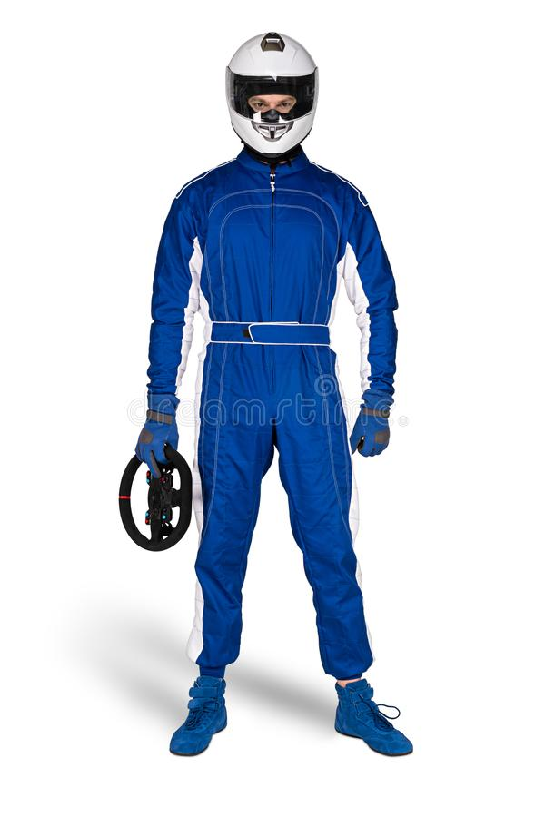 在蓝色白色motorsport整体鞋子手套缺一不可的安全安全帽的坚定的赛车手和被隔绝的方向盘 库存照片
