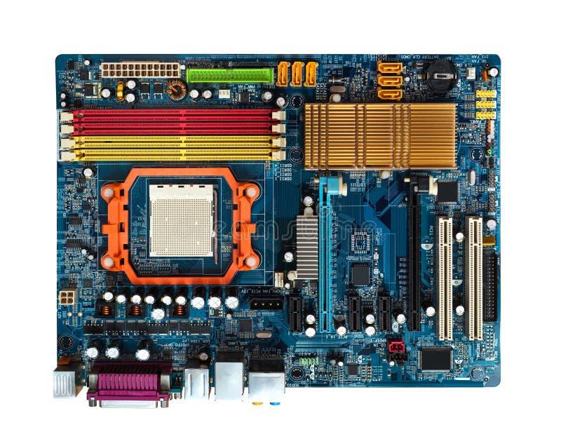 在蓝色的主板与槽孔PCI, AGP, DDR, CPU可看见的吸热器 在视图之上 免版税库存照片
