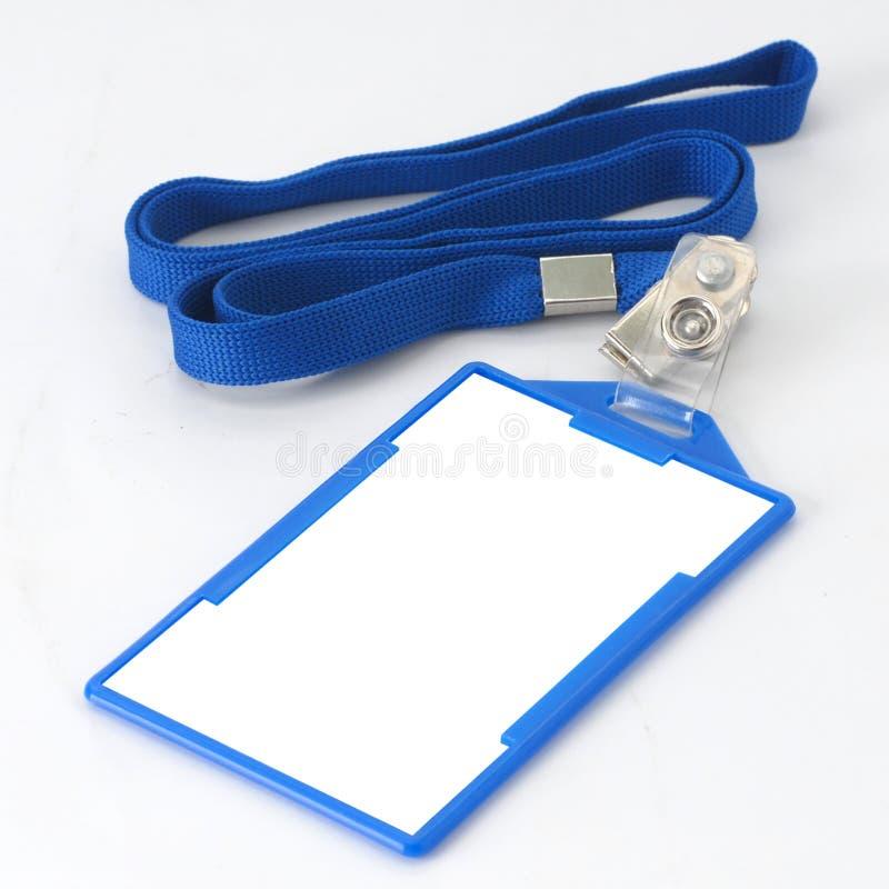 在蓝色皮带的空白徽章 免版税库存照片