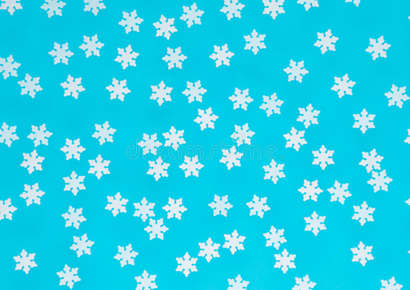 在蓝色纹理背景的圣诞节雪花 库存例证