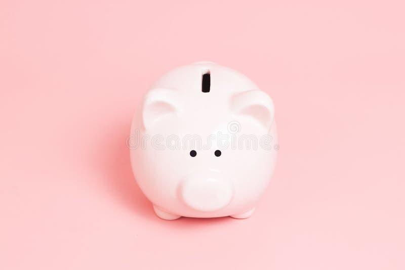 在蓝色背景的存钱罐金钱 免版税库存图片