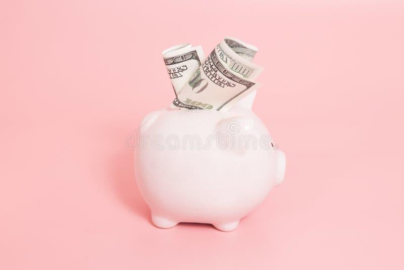 在蓝色背景的存钱罐金钱 图库摄影