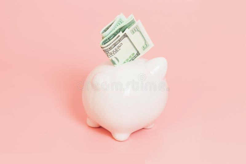 在蓝色背景的存钱罐金钱 免版税图库摄影