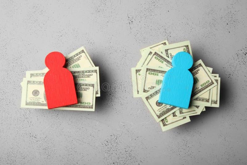 在薪水的水平的不平等 人收入差距 免版税库存照片