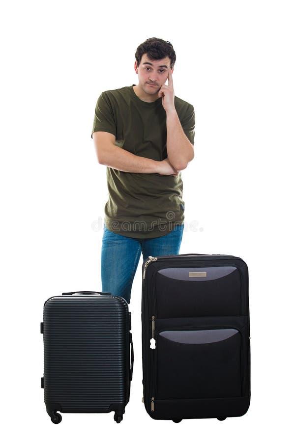 在行李附近的体贴的游人 库存照片