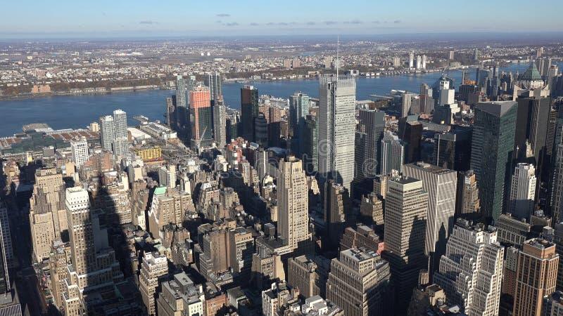 在街市曼哈顿邻里的日落在纽约,美国2019年 免版税图库摄影