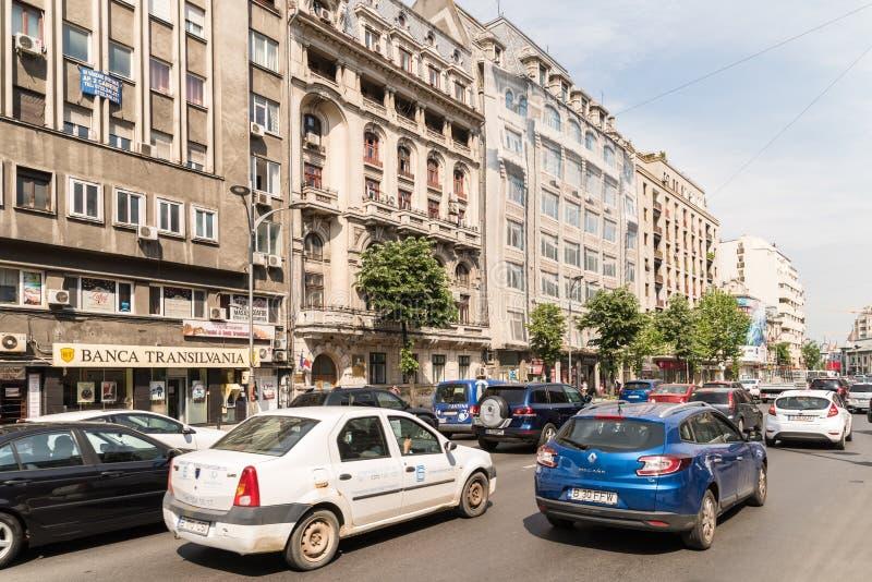 在街市罗马正方形的高峰时间交通 库存图片