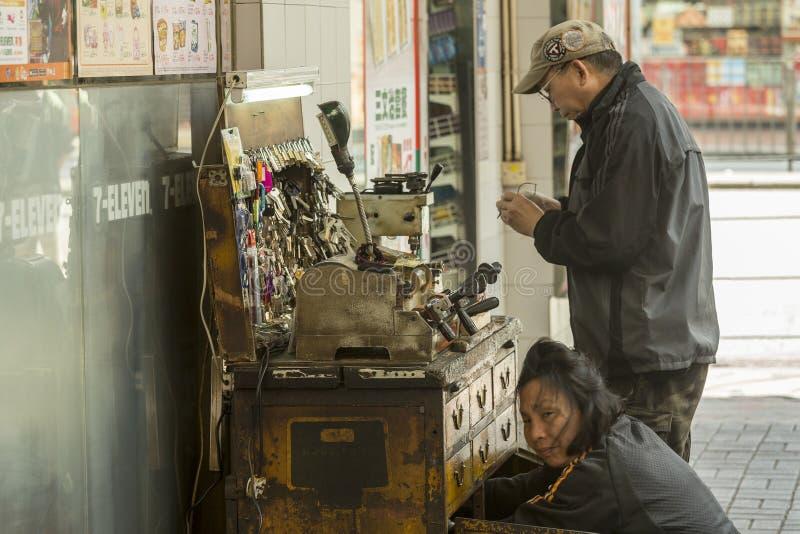 在街道的街道关键服务在香港 免版税库存照片