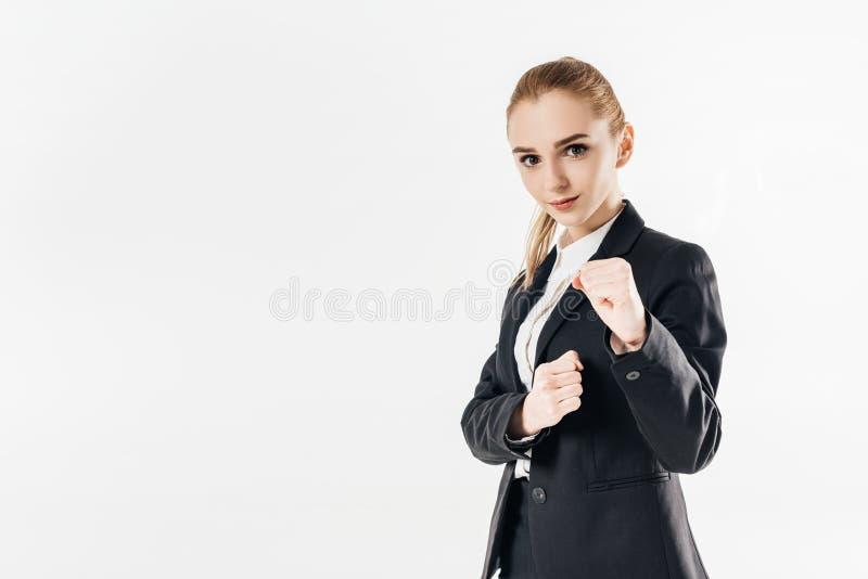 在衣服和显示拳头的女性空手道战斗机身分 免版税库存图片