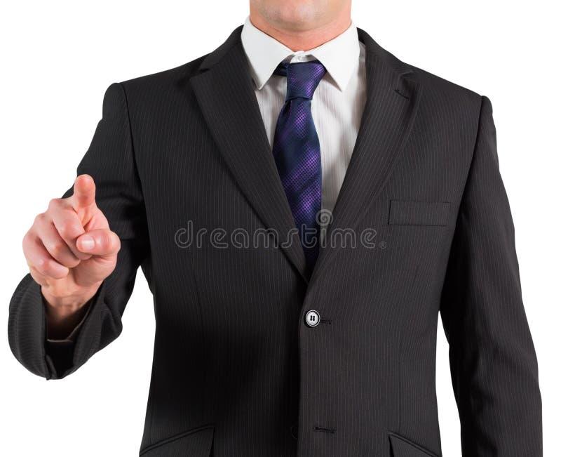 在衣服的商人指向手指的 库存照片