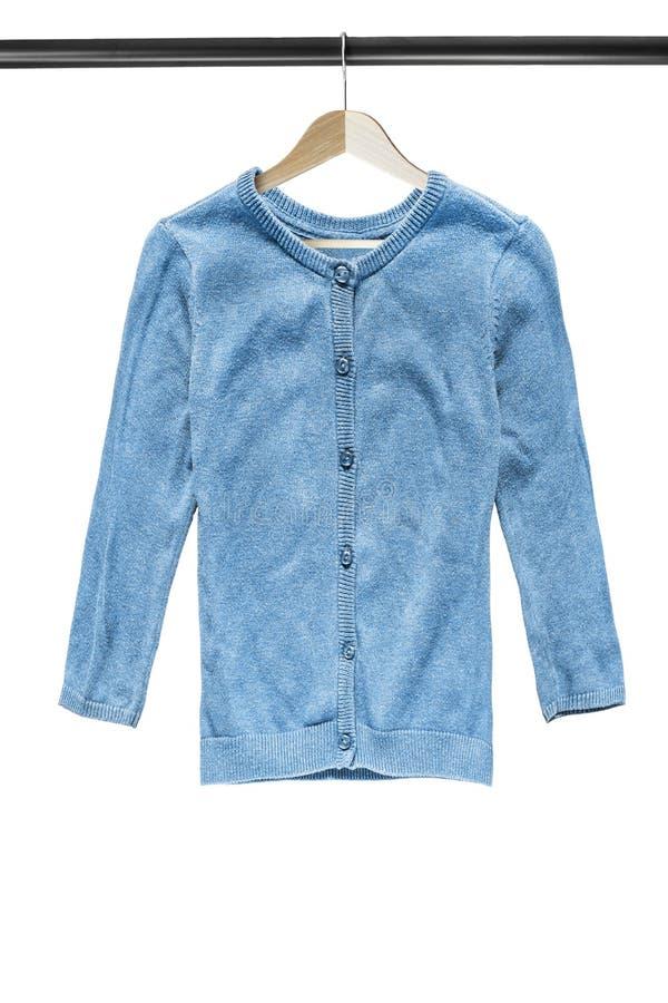 在衣裳机架的羊毛衫 免版税库存照片