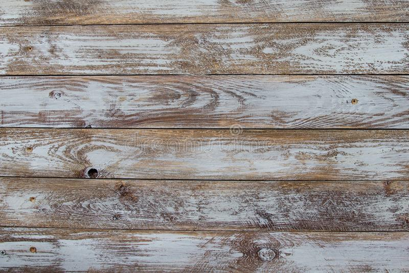 在表面墙壁上镶边的装饰老木头背景和纹理  免版税图库摄影