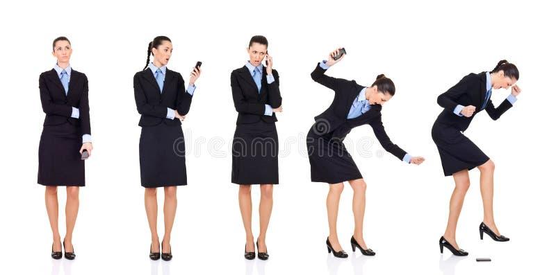 在被接受的电话的坏女实业家新闻 库存图片