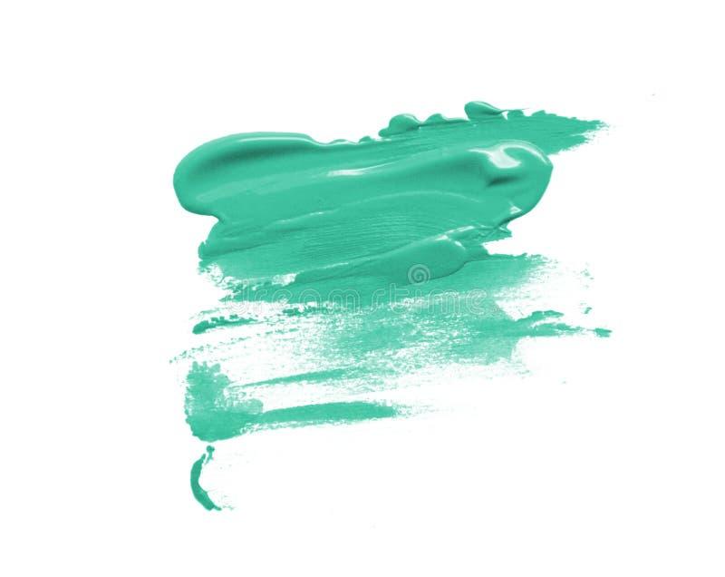 在被隔绝的白色背景的绿松石美好的画笔斑点冲程 免版税库存图片