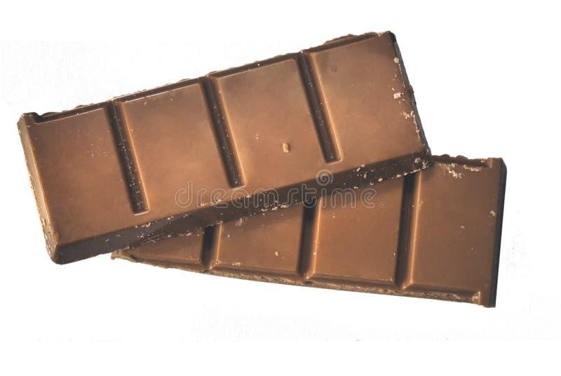 在被隔绝的白色backgrou的巧克力块特写镜头两个片断  图库摄影