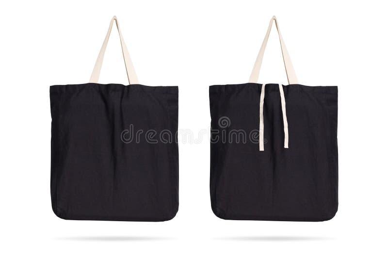 在被隔绝的背景的黑织品袋子与裁减路线 蒙太奇或您的设计模板的购物的囊纺织品 皇族释放例证