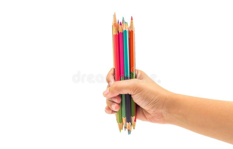 在被隔绝的白色背景的妇女手藏品集合颜色笔 库存图片