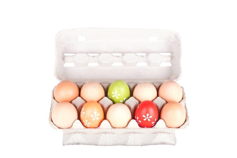 在被隔绝的纸盒包裹的十个鸡蛋 免版税图库摄影
