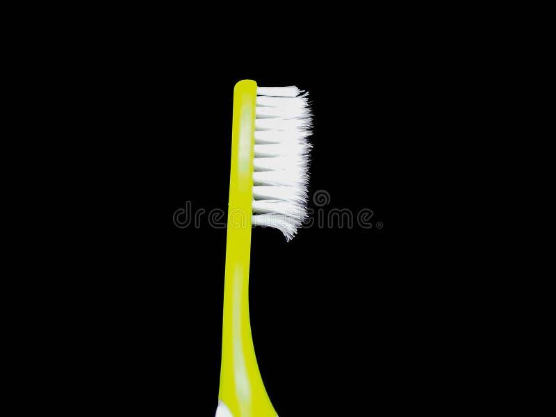 在被隔绝的黑背景的绿色牙刷 免版税库存照片