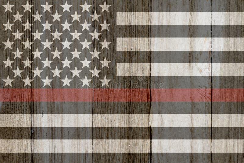 在被风化的木头的一线土气老稀薄的红线旗子 免版税库存图片