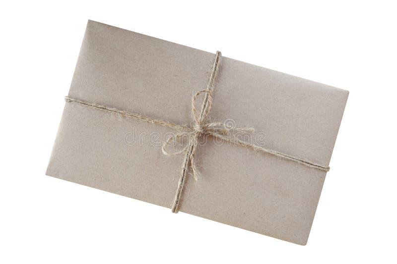 在褐色包裹的礼物盒回收了纸和栓与土气Bu 库存照片