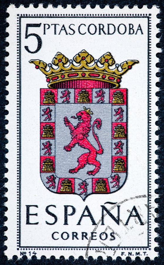 在西班牙打印的邮票致力了省会展示科多巴的胳膊 免版税图库摄影