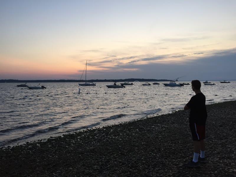 在西部脖子海滩,亨廷顿NY的日落 免版税库存照片