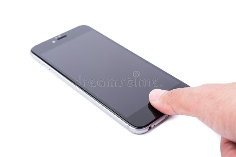 在触摸屏幕的聪明的手机手指接触 免版税图库摄影