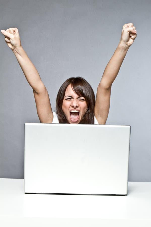 在计算机上的成功 免版税库存图片