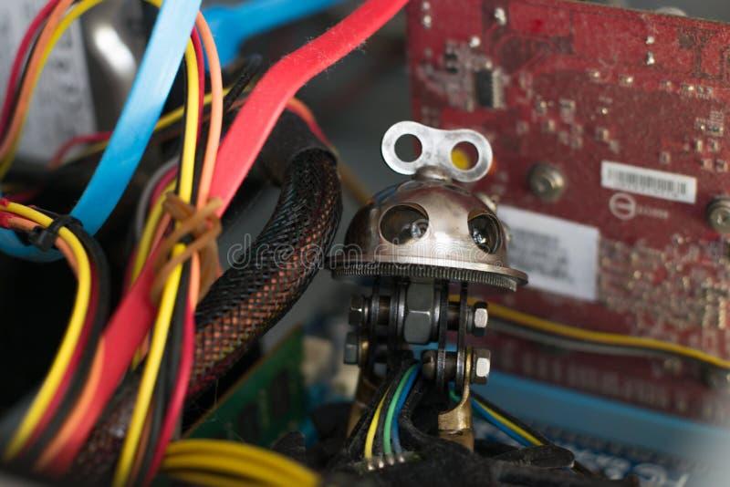 在计算机的机器人 免版税库存图片