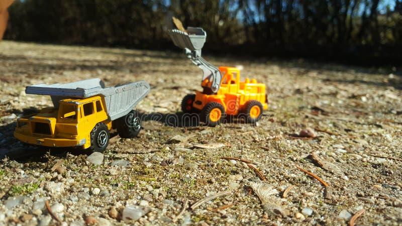 在训练的挖掘机 免版税库存照片