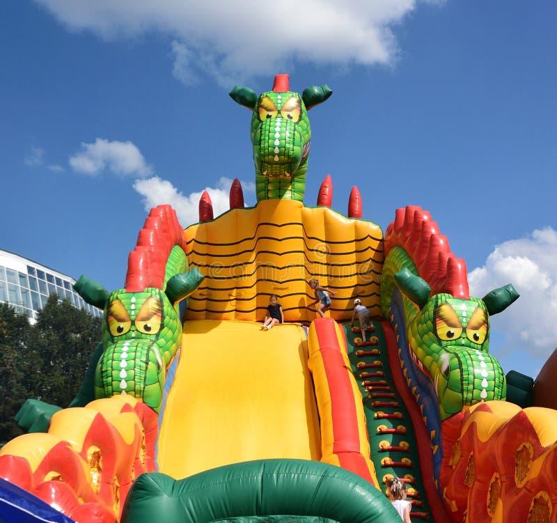 在许多庆祝的儿童inflatables在城市的那天 库存照片
