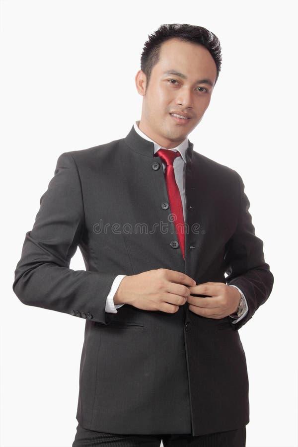 在诉讼白色的亚裔可爱的背景人 库存图片