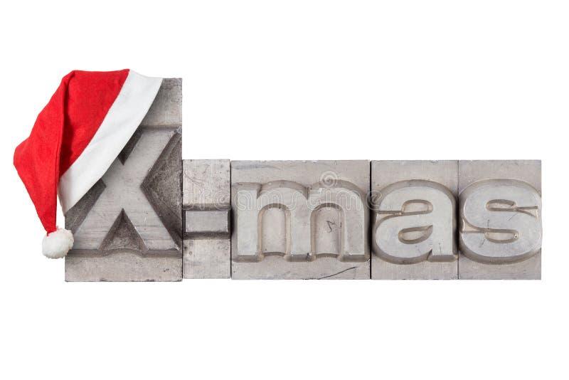 在词X-mas的红色圣诞老人帽子 免版税库存照片