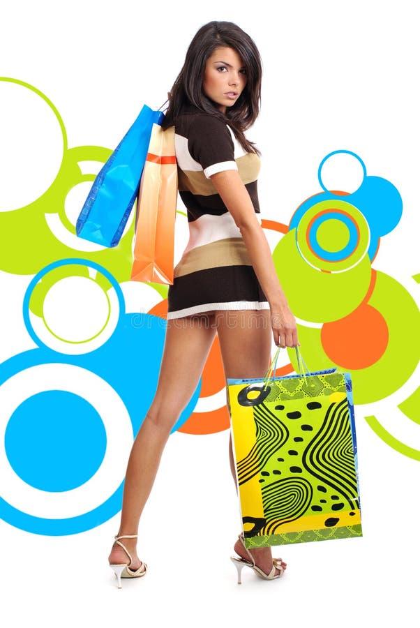 在购物的抽象背景女孩 免版税图库摄影