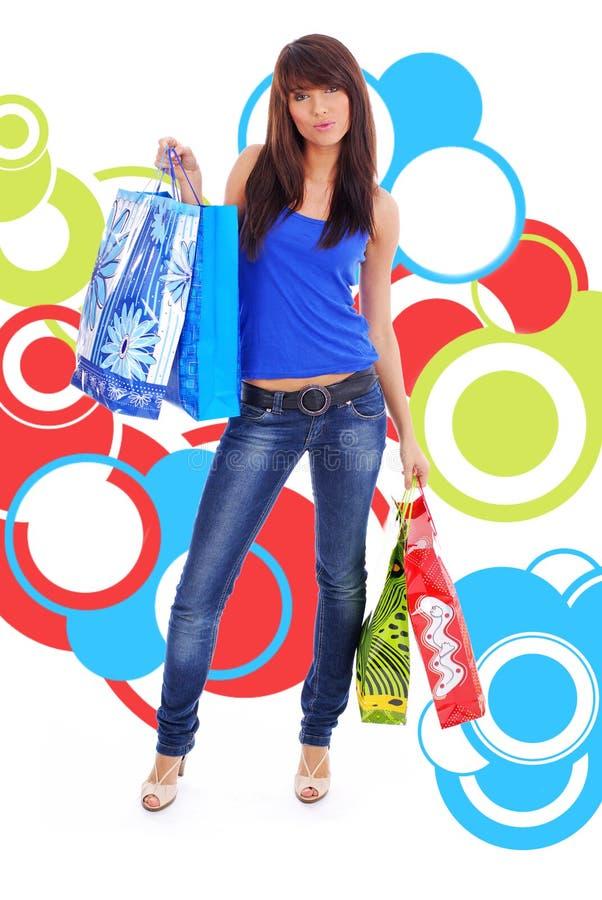 在购物的抽象背景女孩 免版税库存图片