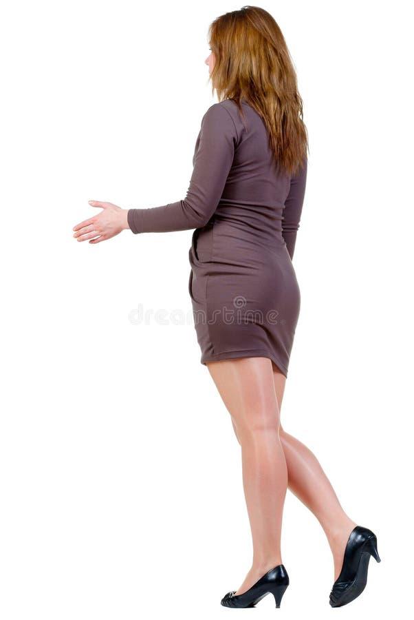 在走的woman& x27的握手; s 库存照片