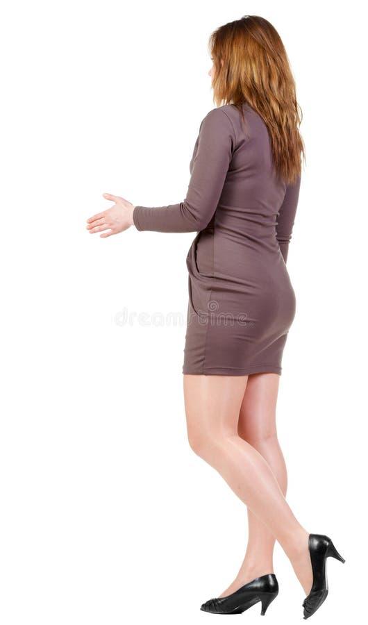 在走的woman& x27的握手; s 图库摄影