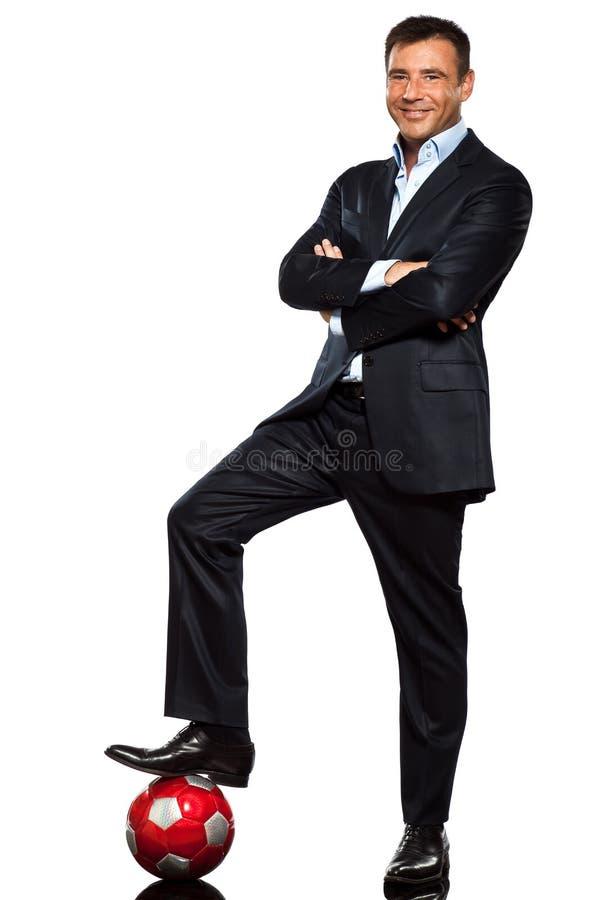 在足球的一只商人常设脚 免版税库存图片