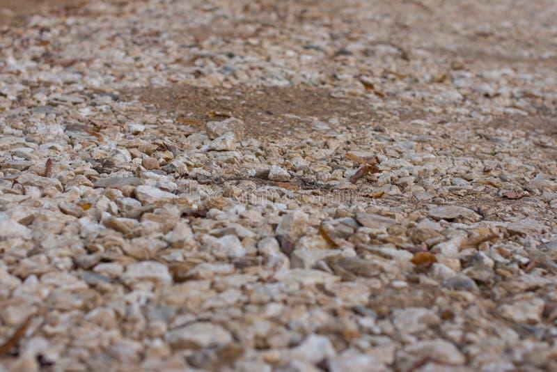 在路的小石头 免版税库存照片