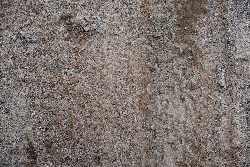 在路的肮脏的沙子 o 库存照片