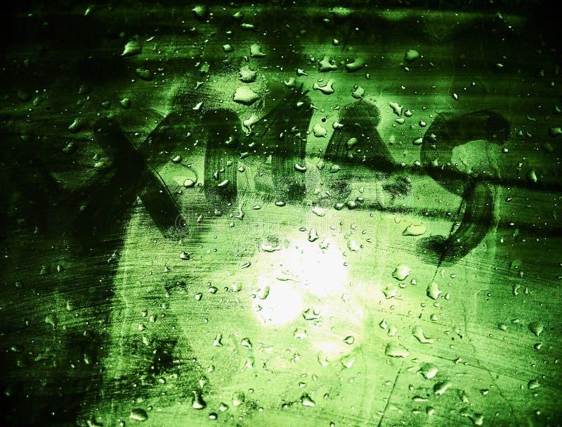 在车窗的大手拉的可怕信件XMAS,深绿背景 免版税库存图片