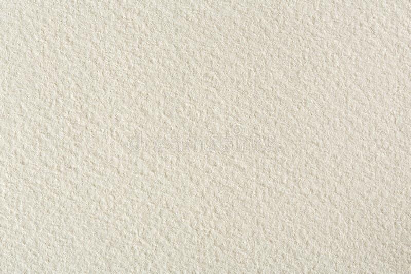 在轻的米黄口气的水彩纸纹理背景 库存图片