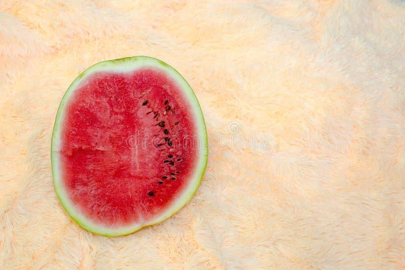 在轻的背景的西瓜 库存图片