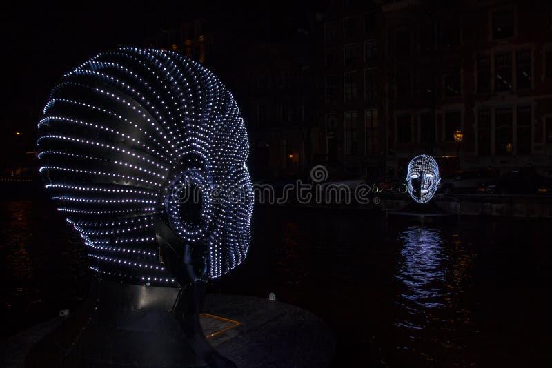在运河的回转刀架在阿姆斯特丹 免版税库存照片