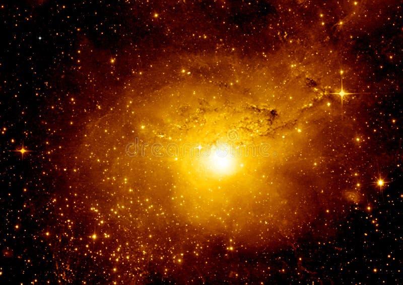 在远的星系的星、尘土和气体星云 免版税库存照片