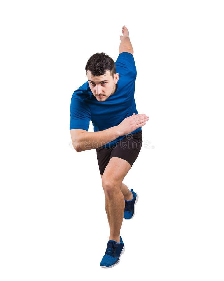 在连续位置朝前看的坚定的白种人人赛跑者身分确信 年轻人短跑选手佩带黑和蓝色 库存图片