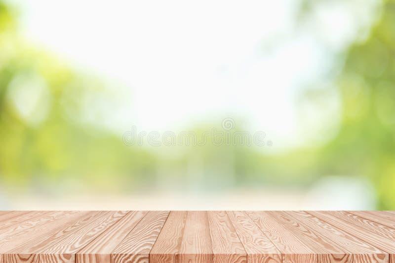 在迷离绿色摘要背景的木台式从自然 图库摄影