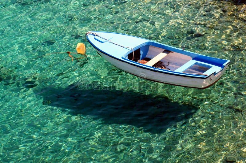 在透明的海运的小船。 免版税库存照片