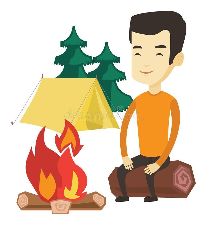 在野营的营火附近供以人员坐日志 皇族释放例证